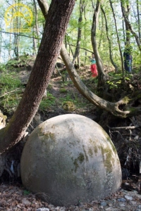 Large Stone sphere stuck in the woods