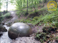 Stone sphere inside a stream.png