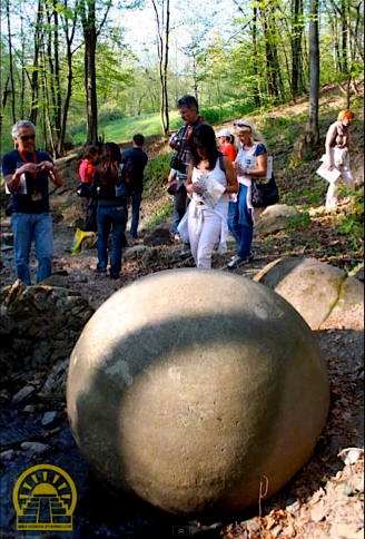 Tourists viewing stone sphere.jpg