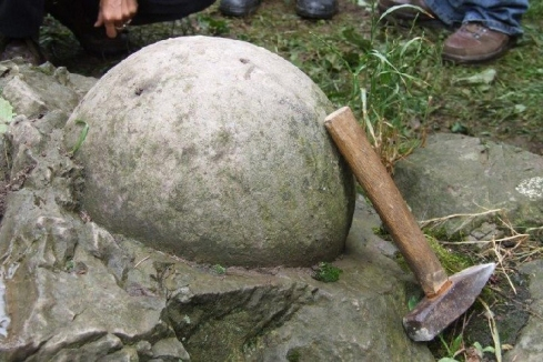 Releasing a stone ball from its surrounding rock.jpg